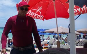 Massage therapist offering massage at Playa Santa Maria