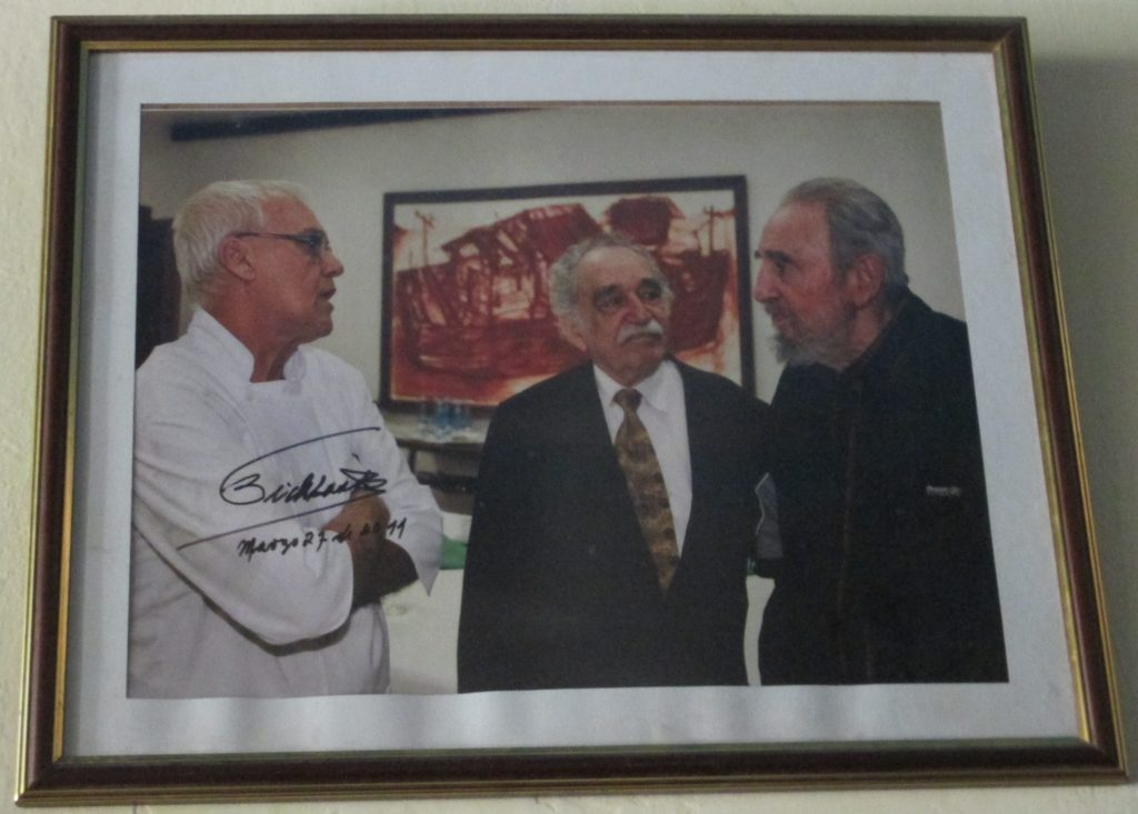 Photo showing Erasmo with Gabriel García Márquez and Fidel Castro